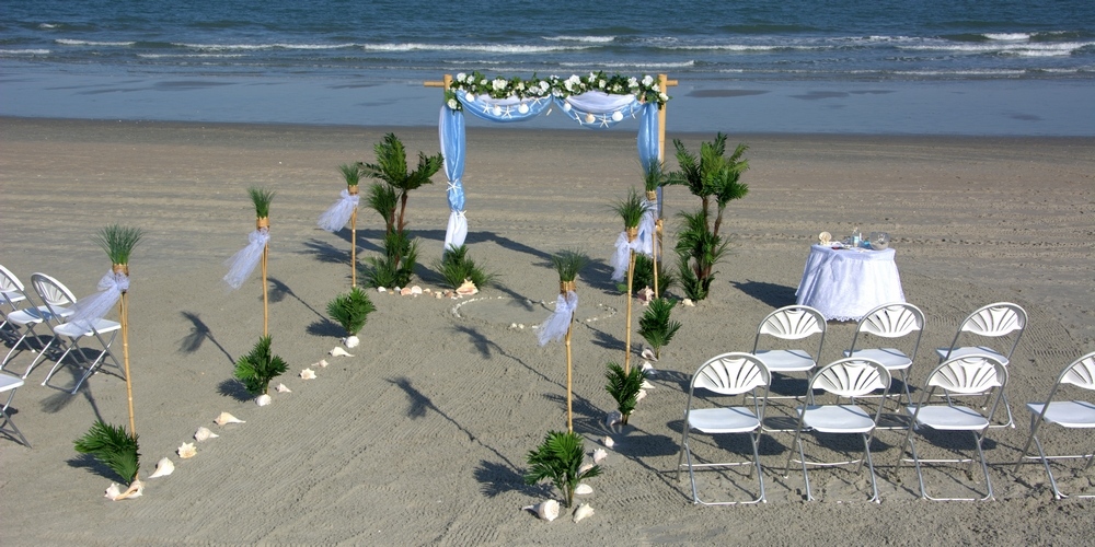 A beautiful Myrtle Beach wedding decoration setting on the beach awaits the bride and groom!