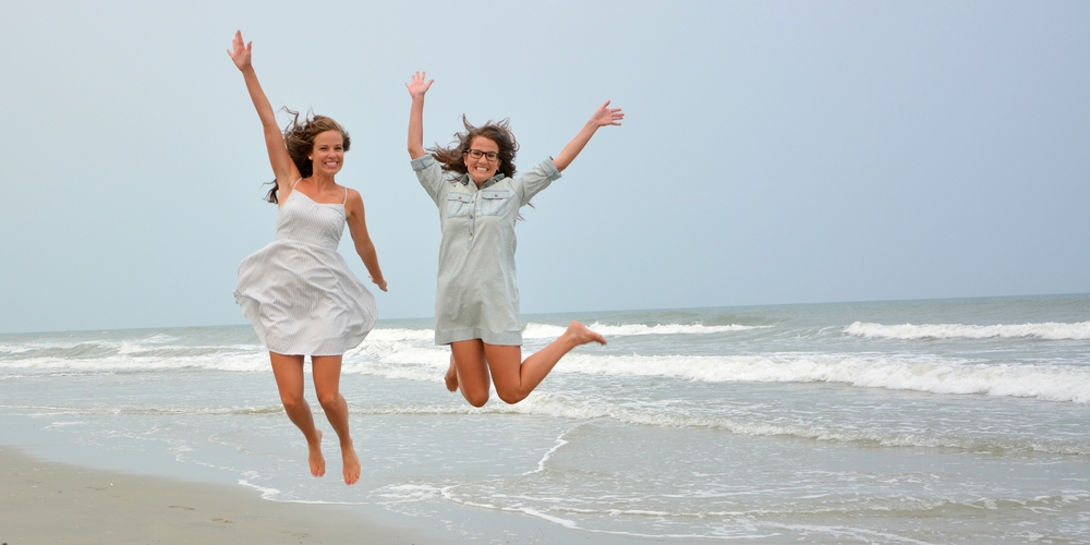 "Myrtle Beach Photographers at the Beach capture the ""Myrtle Beach Jump"" with two wonderful young ladies at a family photo shoot."