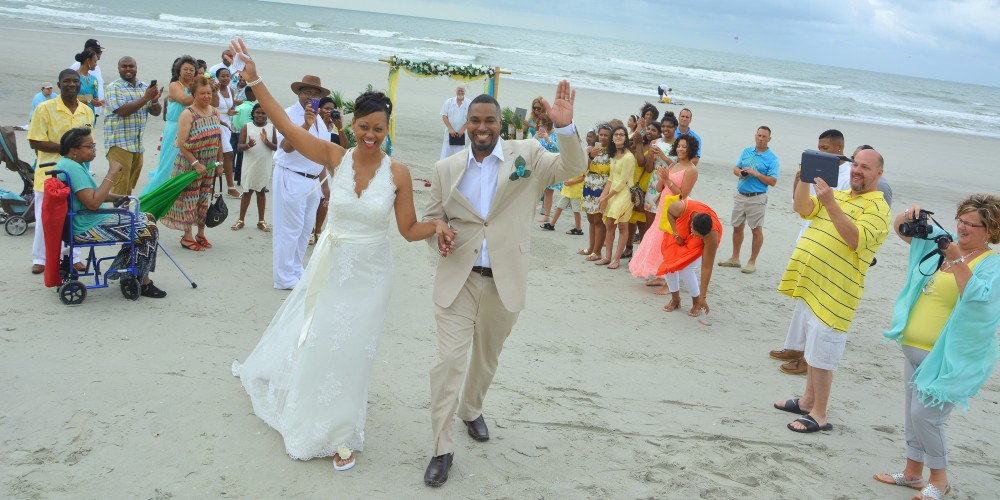 Photographers at the Beach captures an aerial photo of newlyweds taking their first walk as husband and wife. Another beautiful Myrtle Beach wedding photo shoot.